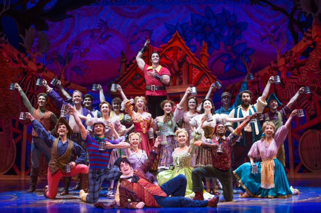 The cartoon-like, talented  Cameron Bond as Gaston and the cast of Disney's Beauty and the Beast. Photo by Matthew Murphy.