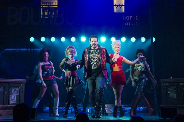 Dane_Stokinger_(center)_as_Lonny_and_the_cast_of_Rock_of_Ages_at_The_5th_Avenue_Theatre_-_Photo_Credit_Tracy_Martin-600x400